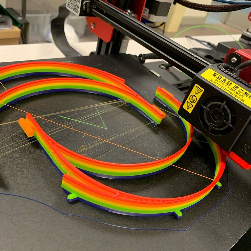 Rainbow headbands being printed. This is done by swapping the filament while it prints